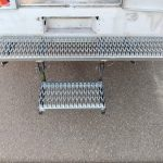 Custom bumper with swing step, mounted on back of truck