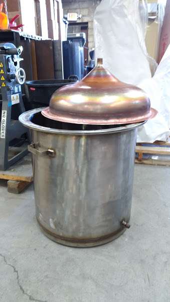 A still with a stainless steel body and copper lid