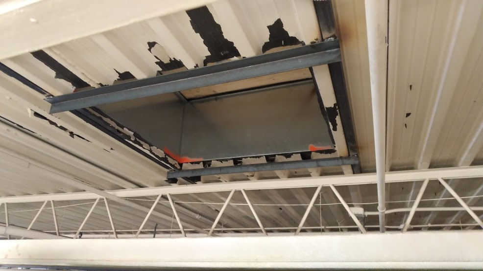 Custom frame supporting hole in flat roof for AC unit