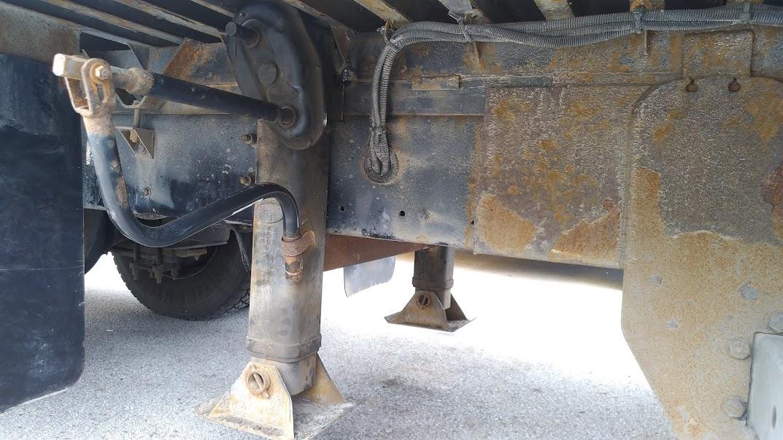 Dolly legs welded onto frame of transport truck