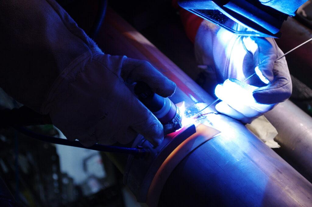 Mobile welder welding stainless steel pipe