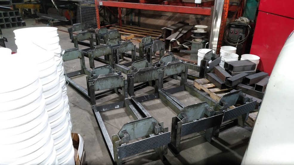 Welded plates onto custom racks so that a machine could better grab them.